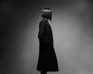 Knowledge Destroys Fear Home image of woman in winter coat with new Bob Haircut.